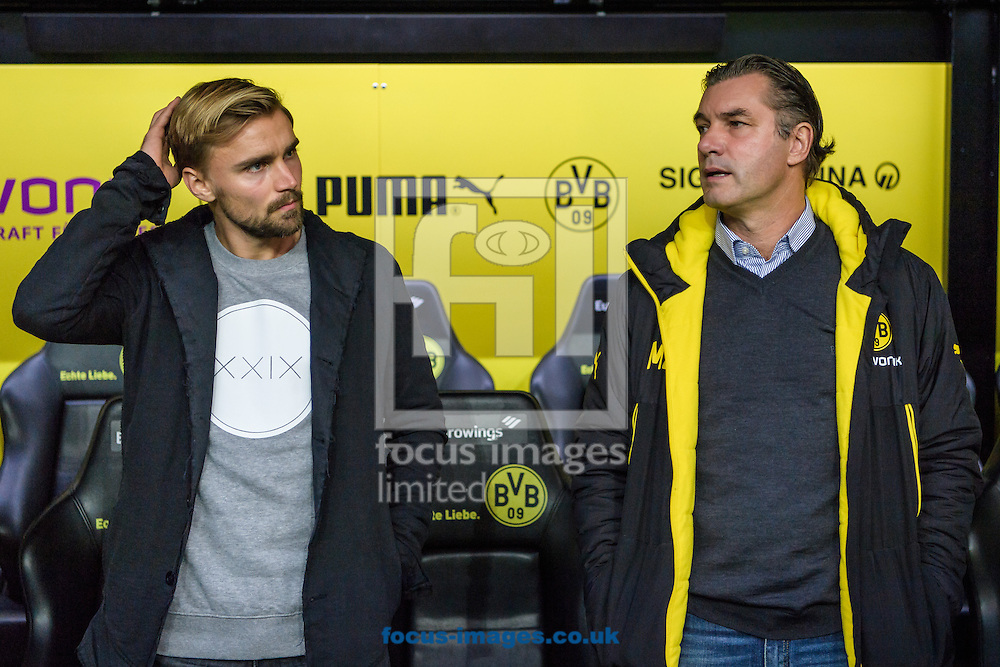 Sporting director Michael Zorc and Marcel Schmelzer of Borussia Dortmund during the Bundesliga match at Signal Iduna Park, Dortmund<br /> Picture by EXPA Pictures/Focus Images Ltd 07814482222<br /> 29/10/2016<br /> *** UK &amp; IRELAND ONLY ***<br /> EXPA-EIB-161030-0014.jpg