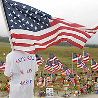 William Ura, age 20 of McKeesport, PA carries an American flag and looks out towards the crash site of Flight 93 while visiting the Temporary Memorial near Shanksville, Pennsylvania  as on September 11, 2006. This is the fifth anniversary of the terrorist attacks on the United States in 2001.   (UPI Photo/Archie Carpenter)
