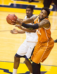 Jan 20, 2016; Morgantown, WV, USA; Texas Longhorns center Prince Ibeh (44) grabs a rebound during the first half against the West Virginia Mountaineers at the WVU Coliseum. Mandatory Credit: Ben Queen-USA TODAY Sports