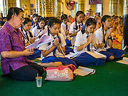 03 APRIL 2016 - CHIANG MAI, THAILAND:  Thai students participate in a meditation and prayer at Wat Chedi Luang in Chiang Mai. The meditation ceremony was in honor of the birthday of Her Royal Highness Princess Maha Chakri Sirindhorn, the daughter of Bhumibol Adulyadej, the King of Thailand. The Princess was born on April 2, 1955. She is revered by Thais and special ceremonies in her honor are held in temples throughout Thailand. Even though there is no school on Sundays, hundreds of students put on the school uniforms and attended the ceremony.      PHOTO BY JACK KURTZ