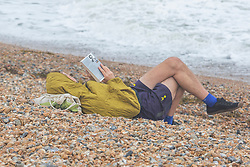 © Licensed to London News Pictures. 17/08/2019. Brighton, UK. Only a handful of visitors can be seen enjoying the beach in Brighton and Hove as colder and grey weather is hitting the seaside resort. Photo credit: Hugo Michiels/LNP