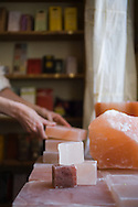 The Meadow, Portland, OR.  Heavy slabs and chuncks of Himalayan Salt at The Meadow, a salt, chocolate, wine and flower shop in the North Mississippi neighborhood of Portland, OR.  The Pink salt blocks can be heated cooled or left at room temperature and can be used for grilling.