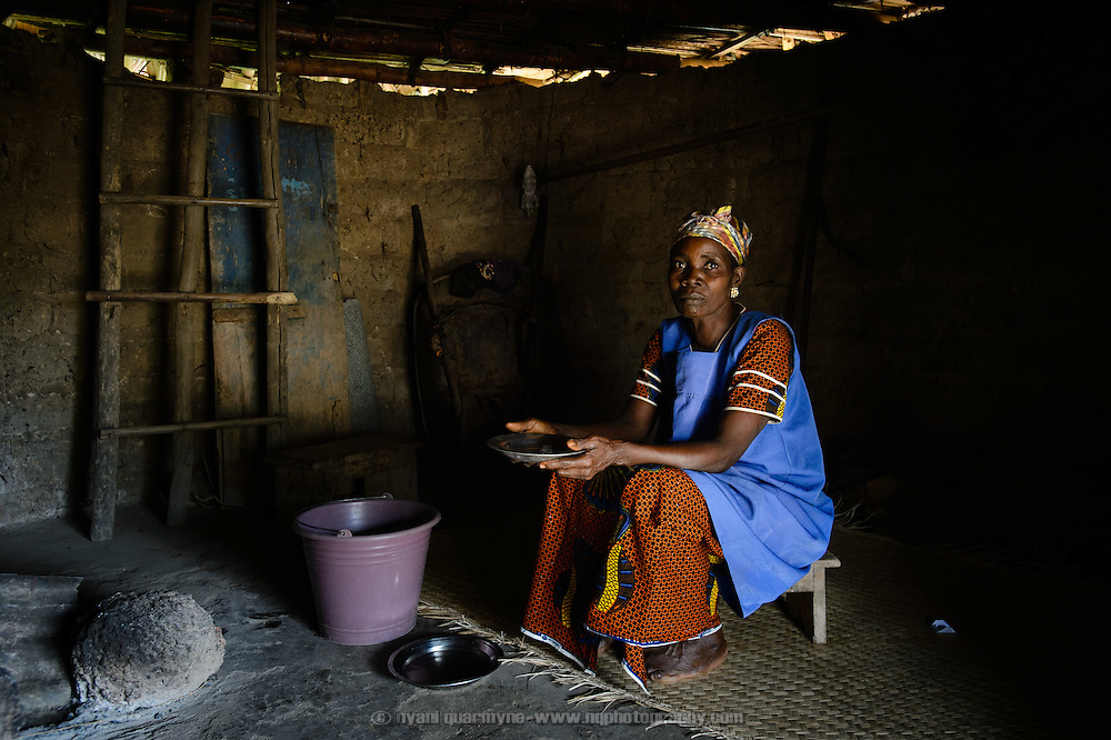 Traditional birth attendant, Antoinette Die Monti, in the village of Yapleu in western Cote d'Ivoire, in the room where she used to deliver babies in the years before the establishment of a local health centre, and also during the years of the country's civil war (2002 - 2007) when the health centre was closed down.