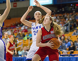Bridgeport guard Hope Chalfant (23) drives the baseline past Fairmont Senior forward Abigail Stoller (24) during a first round game at the Charleston Civic Center.
