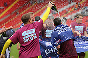Burnley players celebrating winning league during the Sky Bet Championship match between Charlton Athletic and Burnley at The Valley, London, England on 7 May 2016. Photo by Matthew Redman.