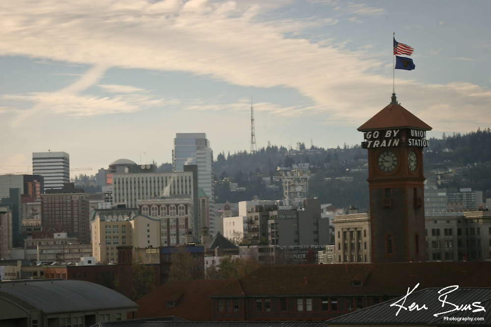 Looking at the Portland downtown skyline from the pearl district. Portland's landmark Go By Train clock is prominently featured.