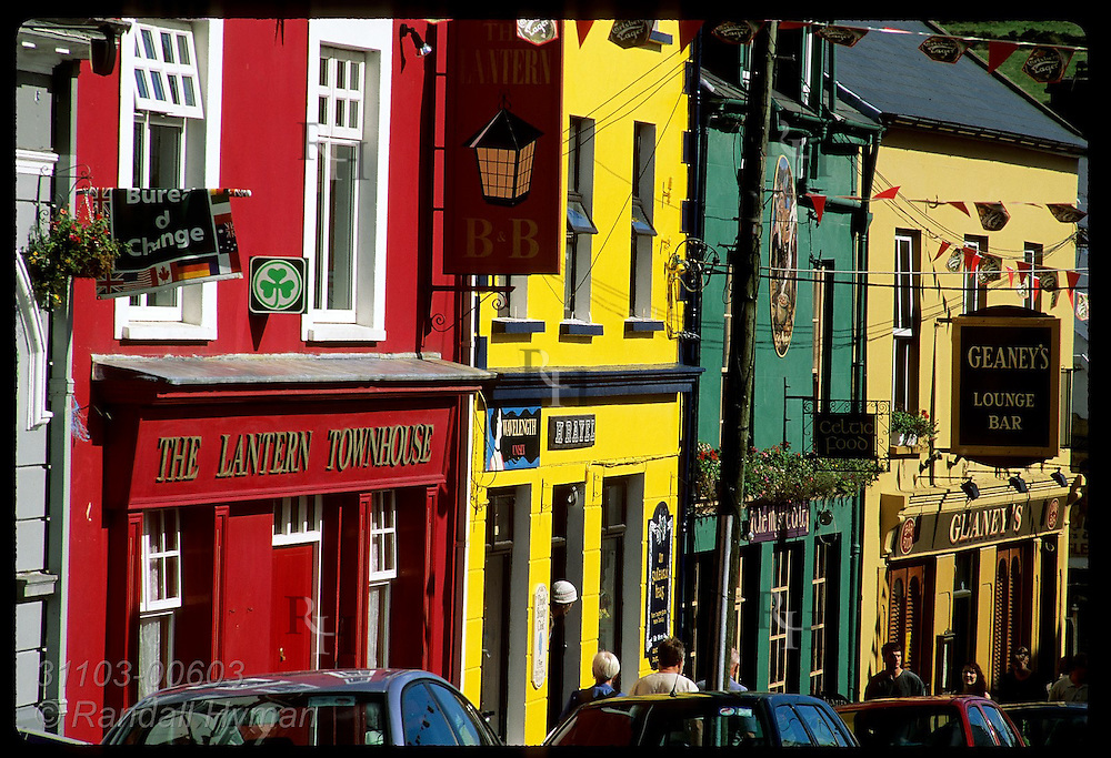 Colorfully-painted shops and pubs line the steep hill of Upper Main Street; Dingle, Ireland.
