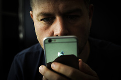 October 1, 2018 - Poland - A man is seen using an Apple iPhone on October 1, 2018 Apples latest realese of its mobile device operating system, version 12 has been plagued by bugs which can send messages to unintended recipients due to a feature which bundles same users who have multiple phone numbers. (Credit Image: © Jaap Arriens/NurPhoto/ZUMA Press)