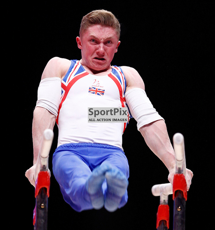 2015 Artistic Gymnastics World Championships being held in Glasgow from 23rd October to 1st November 2015....Great Britain's Nile Wilson performs in the Parallel Bars competition in the Men's Team Final...(c) STEPHEN LAWSON   SportPix.org.uk