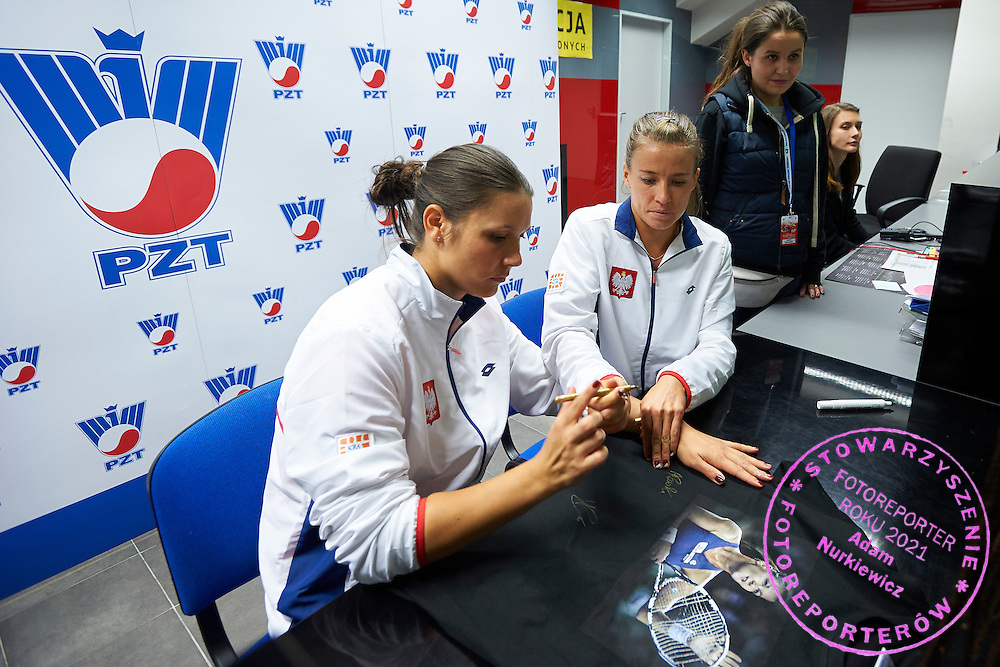 (R) Alicja Rosolska and (L) Klaudia Jans Ignacik both from Poland while their autographs session for supporters during Second Day of the Fed Cup / World Group 1st round tennis match between Poland and Russia at Tauron Krakow Arena on February 8, 2015 in Cracow, Poland.<br /> <br /> Poland, Cracow, February 8, 2015<br /> <br /> Picture also available in RAW (NEF) or TIFF format on special request.<br /> <br /> For editorial use only. Any commercial or promotional use requires permission.<br /> <br /> Adam Nurkiewicz declares that he has no rights to the image of people at the photographs of his authorship.<br /> <br /> Mandatory credit:<br /> Photo by &copy; Adam Nurkiewicz / Mediasport