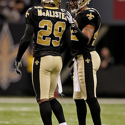 2009 November 30: New Orleans Saints safety Darren Sharper (42) talks with defensive back Chris McAlister (29) during a 38-17 win by the New Orleans Saints over the New England Patriots at the Louisiana Superdome in New Orleans, Louisiana.
