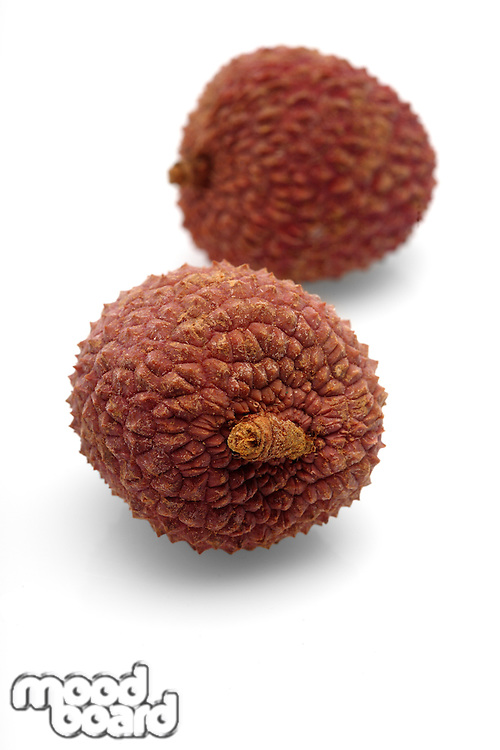 Lychee on white background - close-up