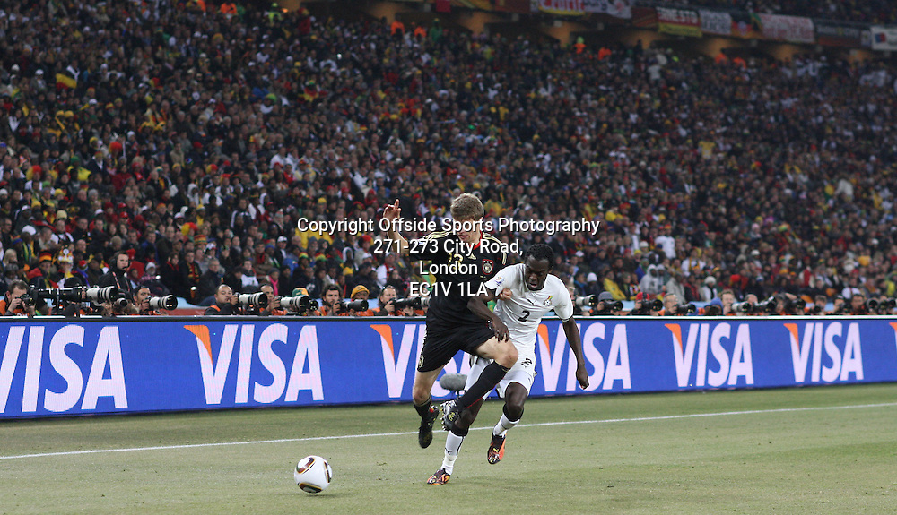 23/06/2010 - 2010 FIFA World Cup - Ghana vs. Germany - Hans Sarpei of Ghana battles with Thomas Mueller of Germany - Photo: Simon Stacpoole / Offside.