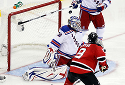 Oct 5, 2009; Newark, NJ, USA; New Jersey Devils left wing Zach Parise (9) hits the post over the shoulder of New York Rangers goalie Henrik Lundqvist (30) during the third period at the Prudential Center. The Rangers defeated the Devils 3-2.