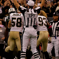 2009 October 04: An official signals for a touchdown after the New Orleans Saints defense recovered a fumble in the endzone during a 24-10 win by the New Orleans Saints over the New York Jets at the Louisiana Superdome in New Orleans, Louisiana.