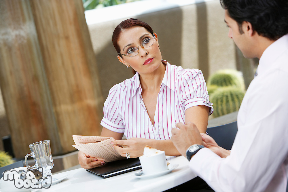 Business woman talking to colleague