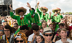 © Licensed to London News Pictures. 28/08/2015. Reading Festival, UK. Festival goers at Reading Festival on Day 1 of the festival dressed as Mariachi musicians watching Mariachi El Bronx perform as opening band on the main stagePhoto credit: Richard Isaac/LNP