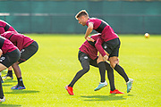 Michael Smith (#2) of Heart of Midlothian FC and Jamie Brandon (#25) of Heart of Midlothian FC in good spirits during training at The Oriam Sports Performance Centre, Heriot Watt University, Edinburgh, Scotland on 24 September 2019, ahead of the Betfred Scottish Football League Cup quarter-final match against Aberdeen. Picture by Malcolm Mackenzie