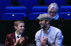Romeo Beckham and David Beckham spectate during day five of the Barclays ATP World Tour Finals at The O2, London.