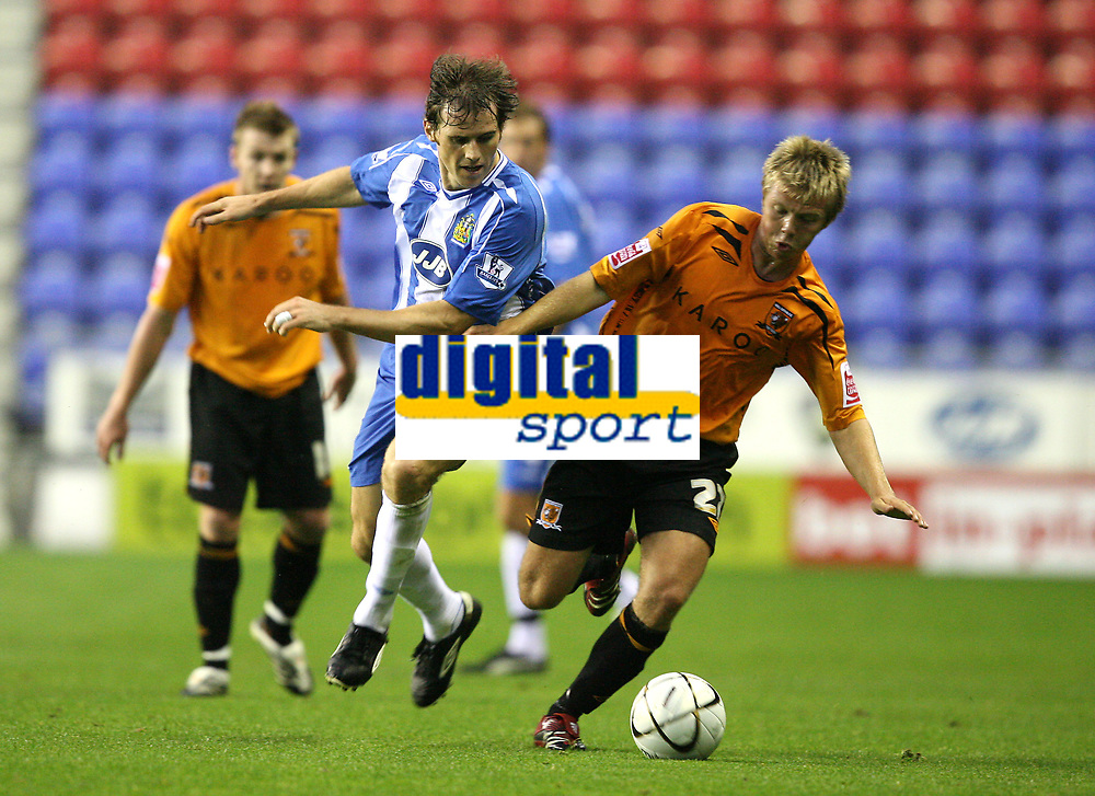 Photo: Sportsbeat Images.<br />Wigan Athletic v Hull City. Carling Cup. 28/08/2007.<br />Hull City's Nicky Featherstone (R) gets the better of Kevin Kilbane
