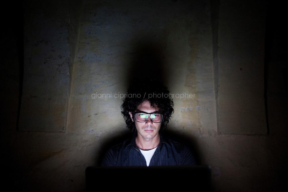 VALLETTA, MALTA - 12 JULY 2013: Luigi Auriemma (32), co-founder with Donato Ferrante of the Maltese firm ReVuln, poses for a portrait in Valletta, Malta, on July 12th 2013.<br /> <br /> ReVuln specializes in finding remote vulnerabilities in control systems.