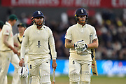 Jonny Bairstow of England and Ben Stokes of England walk back to the pavilion as bad light stops play during the International Test Match 2019, fourth test, day three match between England and Australia at Old Trafford, Manchester, England on 6 September 2019.