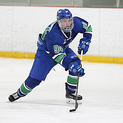 BURLINGTON, ON - SEP 9:  Michael Boushy #94 of the Burlington Cougars skates with the puck in the first period during the OJHL regular season game between the Orangeville Flyers and the Burlington Cougars. Orangeville Flyers and Burlington Cougars  on September 9, 2016 in Burlington, Ontario. (Photo by Tim Bates / OJHL Images)
