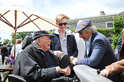Left to right, LORD MONTAGUE OF BEAULIEU, HENRY SCHOFIELD and SIR JACKIE STEWART at a luncheon hosted by Cartier for their sponsorship of the Style et Luxe part of the Goodwood Festival of Speed at Goodwood House, West Sussex on 1st July 2012.