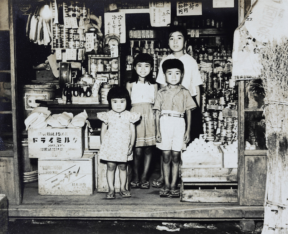 children standing in a small grocery shop Japan Yokosuka late 1940s