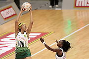06.07.2011 Zanele Mdodana of South Africa(left) manages to get the ball as Gagotheko Tshelametsi looks on during the Pool C match between South Africa VS Botswana, Mission Foods World Netball Championships 2011 from the Singapore Indoor Stadium in Singapore.
