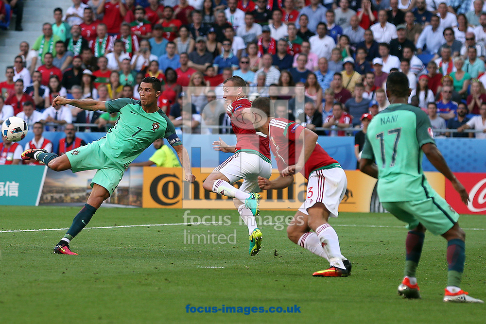 Cristiano Ronaldo of Portugal has a shot on goal during the UEFA Euro 2016 match at Stade de Lyons, Lyons<br /> Picture by Paul Chesterton/Focus Images Ltd +44 7904 640267<br /> 22/06/2016