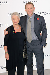 Dame Judi Dench and Daniel Craig pose for photographers at the photocall for the 23rd James Bond movie 'Skyfall', London, Thursday November 3, 2011. Photo By i-Images