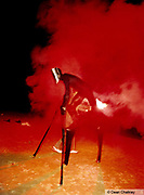 Man on stilts shrowded in red smoke Ibiza 1999