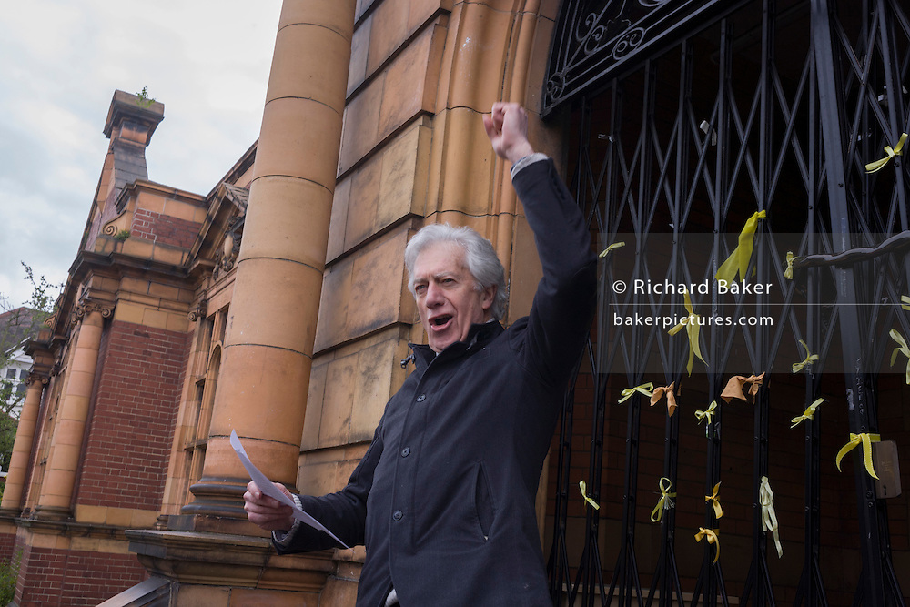 Actor Brian protheroe recites Shakespeare on the 400th anniversary of the Bard's birthday, April 24th, on the steps of the now closed Carnegie Library in Herne Hill, south London. The local community occupied their important resource for learning and social hub and after a long campaign but now Lambeth have gone ahead and closed the library's doors for the last time because they say, cuts to their budget mean millions must be saved. They plan to re-purpose it into a gym although details are unknown.