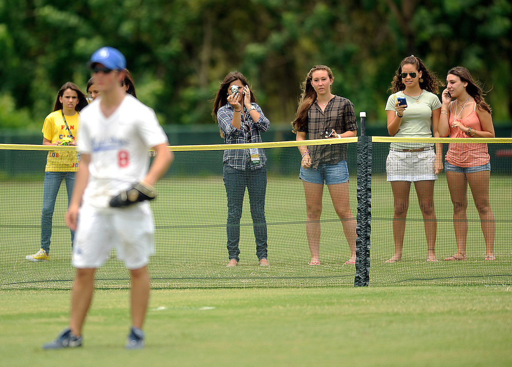 """AUGUST 19, 2009 BOCA RATON FLORIDA- Kevin Jonas, of the Jonas Brothers, gains the attention of his fans in the outfield during their softball game against the Marquis Flyers. The Jonas Brothers and their team, the """"Road Dogs"""" took part in the softball game which was being held by Marquis Jet at the Saint Andrews School in Boca Raton, Fla. Marquis Jet has held 9 other softball games around the country as their company team the """"Marquis Flyers"""" competes in for fun games against various teams. PHOTO BY JOSH RITCHIE"""
