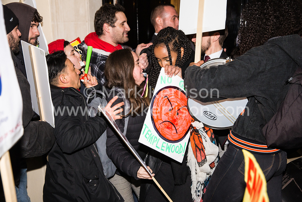 London, UK. 12th February, 2019. Members and supporters of grassroots trade union United Voices of the World try to storm the Gadson Club in Pall Mall on the occasion of a reception with Justice Secretary David Gauke during a protest against his refusal to negotiate with the trade union over their demands for the London Living Wage, annual leave and sick pay for outsourced cleaners, security guards and receptionists working at the Ministry of Justice, all of whom have been on strike for varying periods recently. The Gadson Club is the official alumni club for the Oxford University Conservative Association.