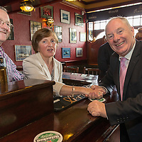 John Power and his wife Eilish with Michael Ring, TD Junior Minister for Sports in their  pub Powers, during the Official opening of 'The Castle', Antique, Arts & Craft Centre in Clarecastle