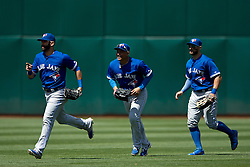 OAKLAND, CA - JULY 23:  Jose Bautista #19 of the Toronto Blue Jays; Danny Valencia #23 and Kevin Pillar #11 celebrate after the game against the Oakland Athletics at O.co Coliseum on July 23, 2015 in Oakland, California. The Toronto Blue Jays defeated the Oakland Athletics 5-2. (Photo by Jason O. Watson/Getty Images) *** Local Caption *** Kevin Pillar; Jose Bautista; Danny Valencia