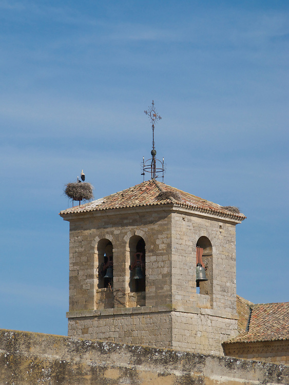 The church tower with a stork nest in Church in Boadilla del Camino, North Spain. Many churches had stork nests and some like this one had structures to allow the birds to build their nests.