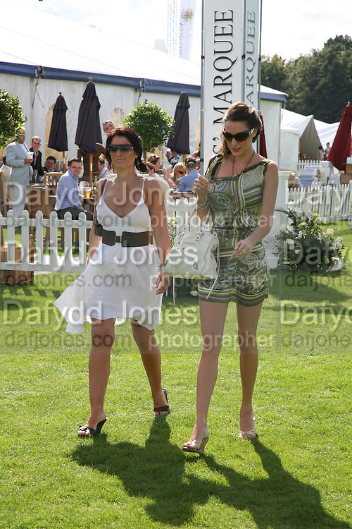 Laura Inglis and Laura Zilli, Cartier International Polo. Guards Polo Club. Windsor Great Park. 29 July 2007.  -DO NOT ARCHIVE-© Copyright Photograph by Dafydd Jones. 248 Clapham Rd. London SW9 0PZ. Tel 0207 820 0771. www.dafjones.com.