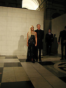 Dr. Santo Versace and Donatella Versace. Versace exhibition opening. V. & A. 14 October 2002. © Copyright Photograph by Dafydd Jones 66 Stockwell Park Rd. London SW9 0DA Tel 020 7733 0108 www.dafjones.com