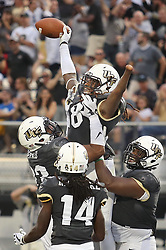 File photo - UCF players hoist linebacker Shaquem Griffin (18) into the air after he returned a fumble 20 yards for a touchdown in the second quarter against Austin Peay at Spectrum Stadium in Orlando, Fla., on Saturday, Oct. 28, 2017. UCF won, 73-33. The 22-year-old linebacker from the University of Central Florida has become the first one-handed player to be drafted into the NFL on Saturday (April 28) at the 2018 NFL Draft at the AT&T Stadium in Arlington, TX, USA. Photo by Stephen M. Dowell/Orlando Sentinel/TNS/ABACAPRESS.COM
