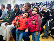 16 MARCH 2019 - BLOOMINGTON, MINNESOTA, USA: A man and his sons at Dar al Farooq Center in Bloomington. An interdenominational crowd of about 1,000 people came to the center to protest white supremacy and religious intolerance and to support Muslims in New Zealand who were massacred by a white supremacist Friday. The Twin Cities has a large Muslim community following decades of Somali immigration to Minnesota. There are about 45,000 people of Somali descent in the Twin Cities.   PHOTO BY JACK KURTZ