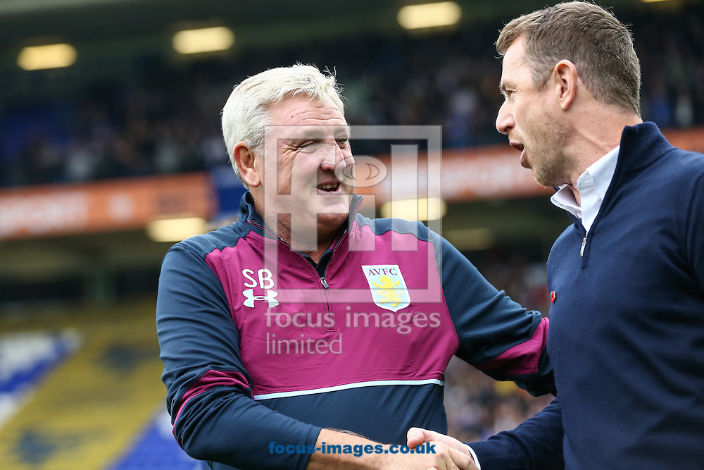 Birmingham City manager Gary Rowett (right) greets Aston Villa manager Steve Bruce (left) during the Sky Bet Championship match at St Andrews, Birmingham<br /> Picture by Andy Kearns/Focus Images Ltd 0781 864 4264<br /> 30/10/2016
