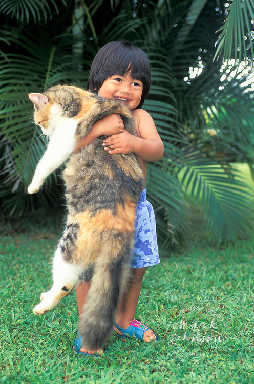Boy carrying large patient pet cat