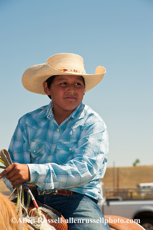 Crow Fair, Indian rodeo, kid, breakaway roper, Crow Indian Reservation, Montana.