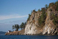 North America, United States, Washington, San Juan Islands, cliff and lighthouse, Strait of San Juan de Fuca