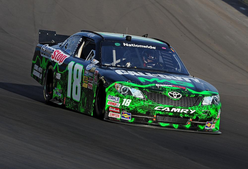 Nov. 12 2011; Avondale, AZ, USA; NASCAR Nationwide Series driver Joey Logano (18) races during the Wypall 200 at Phoenix International Raceway. Mandatory Credit: Jennifer Stewart-US PRESSWIRE