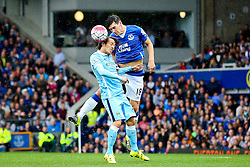 David Silva of Manchester City challenges Everton's Gareth Barry for a header - Mandatory byline: Matt McNulty/JMP - 07966386802 - 23/08/2015 - FOOTBALL - Goodison Park -Everton,England - Everton v Manchester City - Barclays Premier League