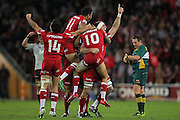 Queensland Reds celebrate their victory following the Super Rugby Final at Suncorp Stadium in Brisbane,  July 9, 2011.  Photo: Patrick Hamilton/Photosport